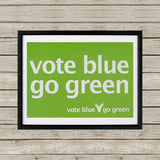 Vote blue go green Black Framed Print (Lifestyle)