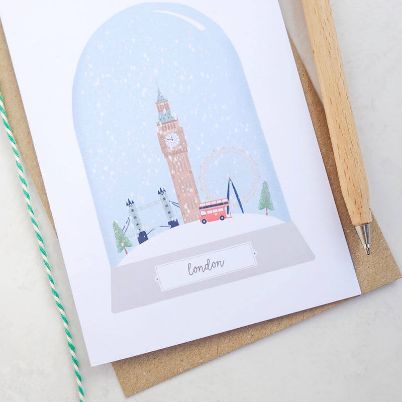 A close up of the snow globe illustration on the London Christmas card.