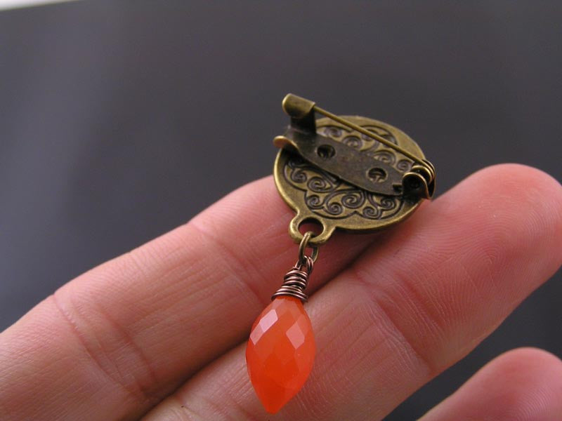 Ornate Brooch with wire wrapped Carnelian