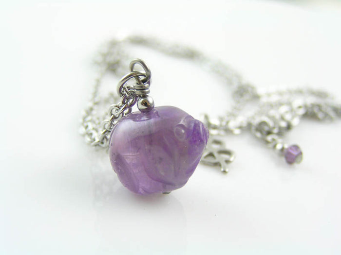 Carved Amethyst Pig Necklace