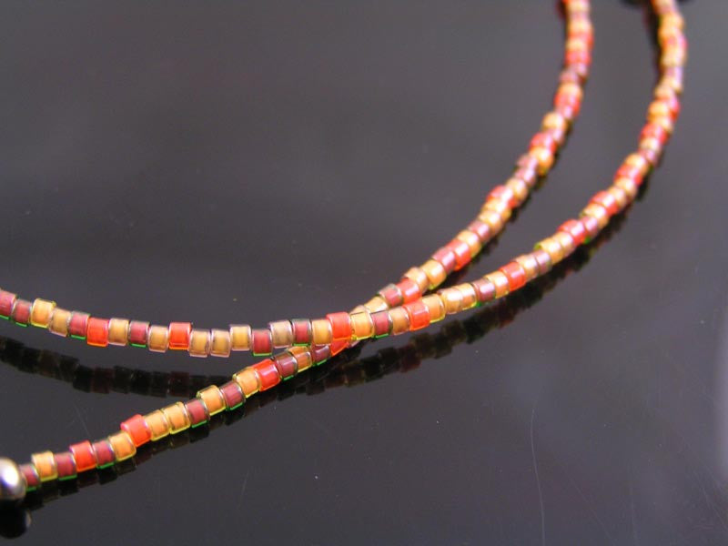 Beaded Necklace in Orange and Brown with Pumpkin and Apple Charm