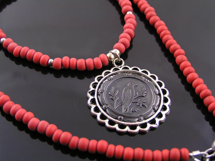 Red Necklace with Black Raven Pendant