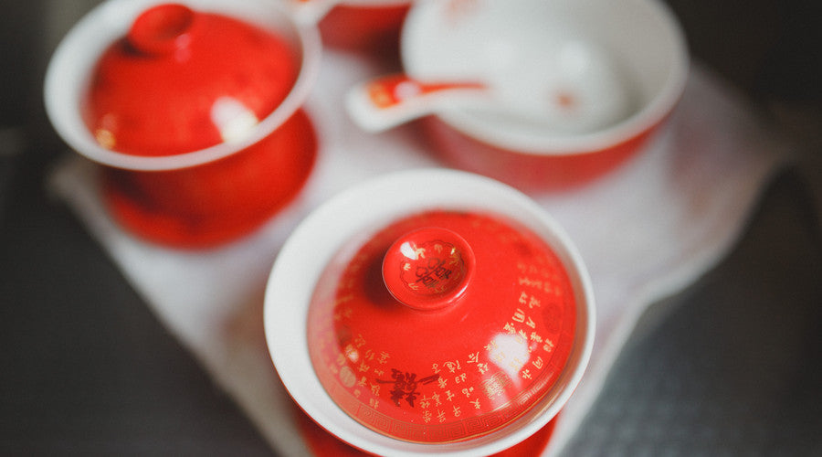 Chinese wedding tea served in traditional red Gaiwan