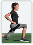 Woman lunging with a resistance band around thighs