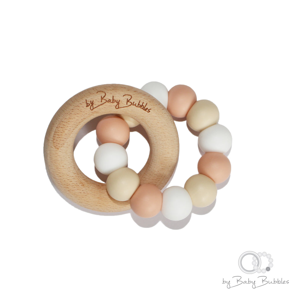 Peach cream and white silicone and wood baby teether toy