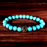 The Lion Turquoise & Gold Bead Stretch Bracelet