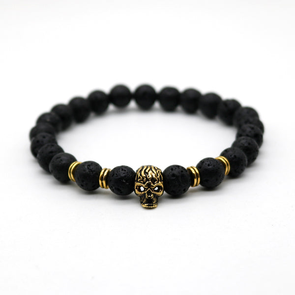 Skull Master Black Lava Stone Beaded Stretch Bracelet With Gold Colored Skull Charm