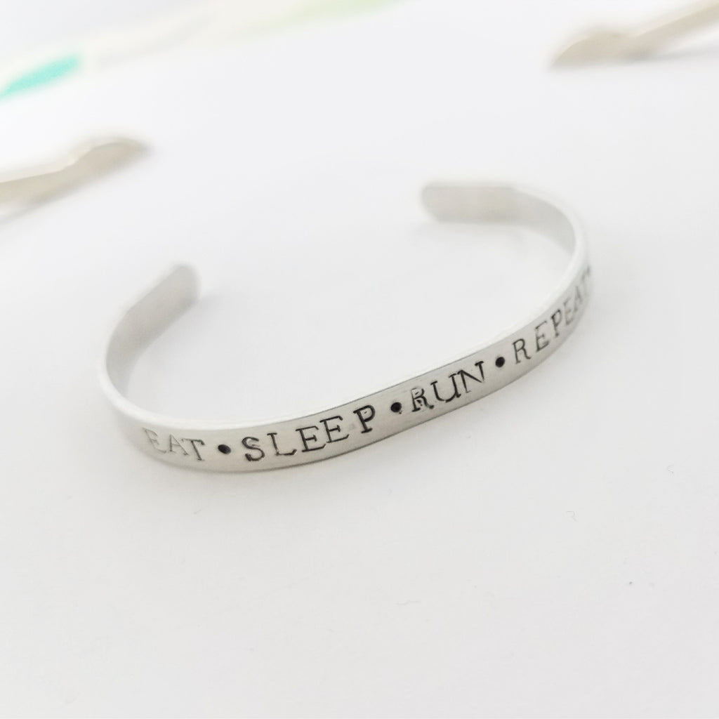 Eat. Sleep. Run. Repeat. Hand Stamped Runner's Bracelet. Adjustable Inspirational Cuff for Runners