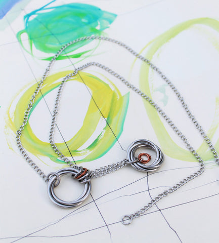 Movable Jewelry: Infinity Rings Balanced on Stainless Steel Chains Necklace