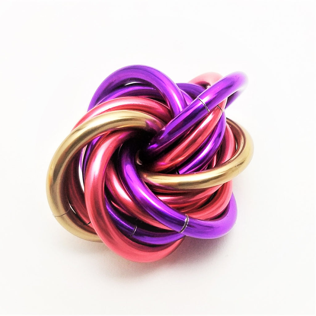 Möbii Cheshire Cat: Small Mobius Hand Fidget Toy, Shiny Purple, Pink, and Champagne Stress Ball