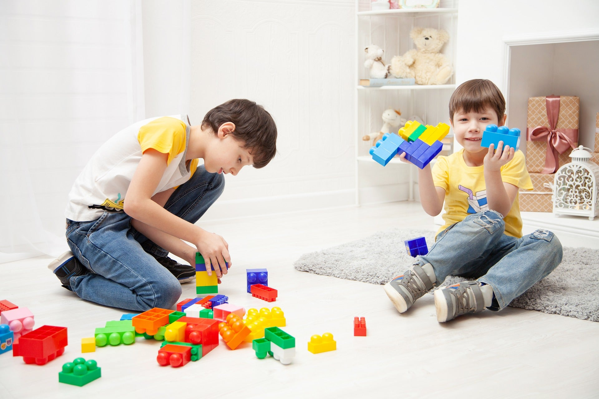 two boys playing colorful blocks