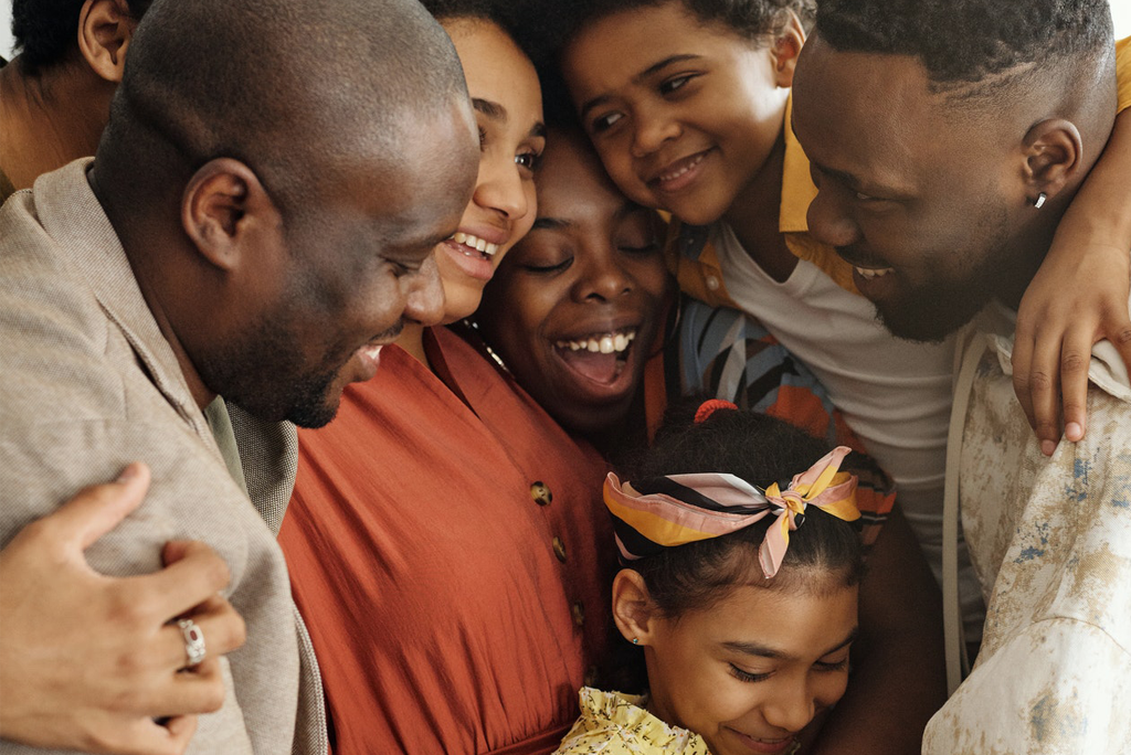Black History Month: Black Family hugging.