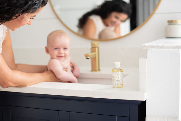 memeeno baby massage oil collection baby in bath with mama
