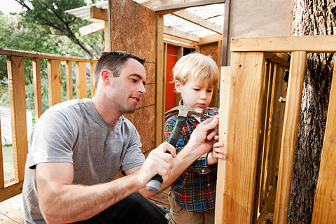 Father and son building a treehouse