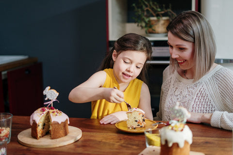 Mom and daughter eating cake
