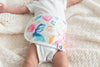 close up of baby wearing an Aquarelle baby belly band