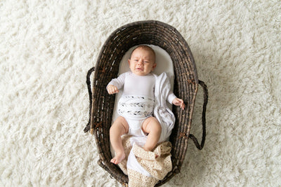 baby in basket wearing organic cotton feathers memeeno baby belly bloomer