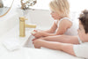 kids washing hands at sink with all natural olive oil soap