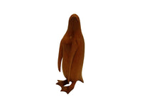 Penguin wood carving