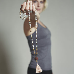 Lady holding in the hand Gemstone Mala with Rudraksha, Manipura - Handmade in Amsterdam
