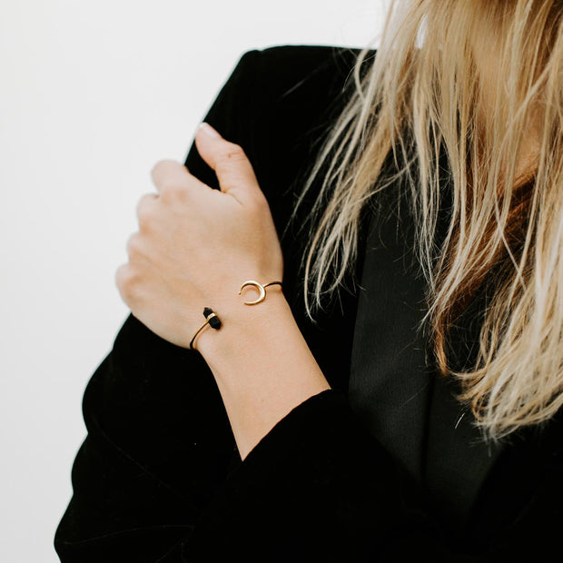 Gold Bangle with Obsidian Crystal and Moon by Manipura worn on a wrist
