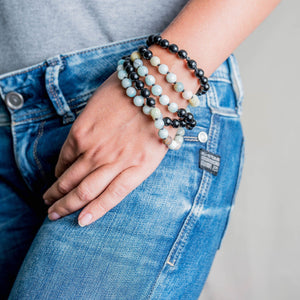 Amazonite and Black Onyx Gemstone Mala on a wrist of a woman, Manipura - Handmade in Amsterdam