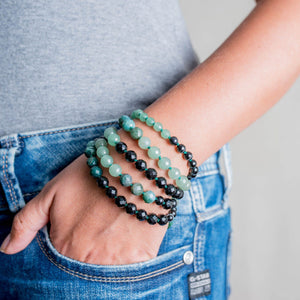Lady wearing Green Agate and Black Onyx Gemstone Mala on the wrist, Manipura - Handmade in Amsterdam