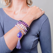 women wearing mala on wrist
