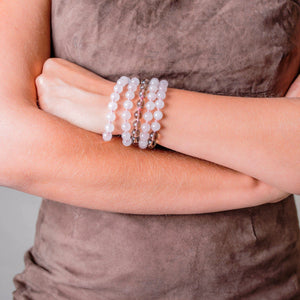 Lady wearing a Gemstone Mala with Rose and Smokey Quartz on her wrist - Handmade by Manipura