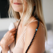 Woman smiling with Black Mat and shiny Onyx Gemstone Mala Unisex, Manipura - Handmade in Amsterdam