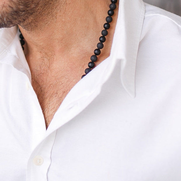 Man in white shirt wearing Black Onyx  Gemstone Mala Unisex, Manipura - Handmade in Amsterdam