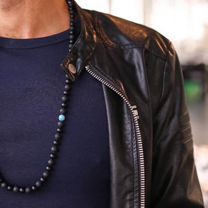 Man in Black wearing Black Onyx and Apatite Gemstone Mala Unisex, Manipura - Handmade in Amsterdam
