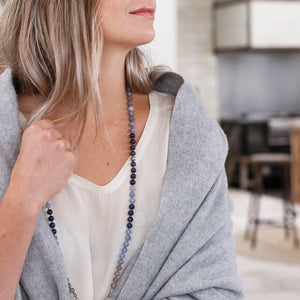 Woman with Grey scarf wearing Blue Gemstone Mala, Manipura - Handmade in Amsterdam