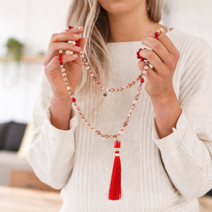 Lady holding in hands Peach Moonstone and red Coral Gemstone Mala, Manipura - Handmade in Amsterdam