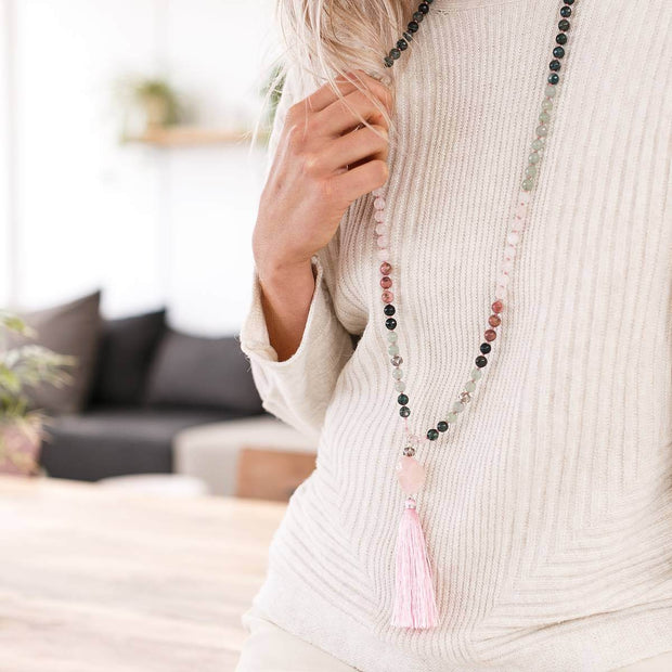 Woman holding Rose Quartz, Rhodonite and Green Jade Gemstone Mala, Manipura - Handmade in Amsterdam