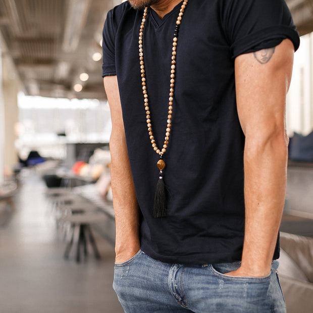 Man wearing Jasper, Onyx and Tiger Eye beads Gemstone Mala, Manipura - Handmade in Amsterdam