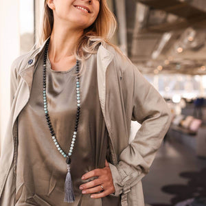 Lady smiling with Beautiful Gemstone  Mala, Manipura - Handmade in Amsterdam