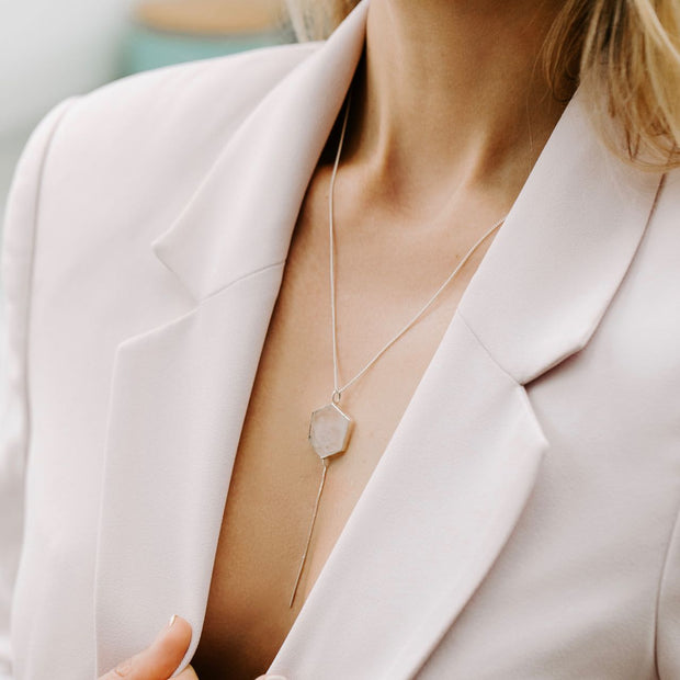 Rose Quartz Hexagon Silver Tie Necklace Manipura on a lady with Pink Cardigan