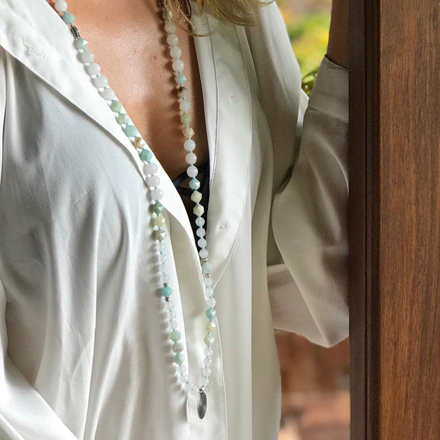 Lady wearing White Jade and Amazonite Gemstone Mala Manipura