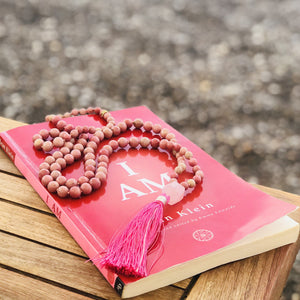 Rhodonite and Rose Quartz Gemstone Mala on a book, Manipura - Handmade in Amsterdam