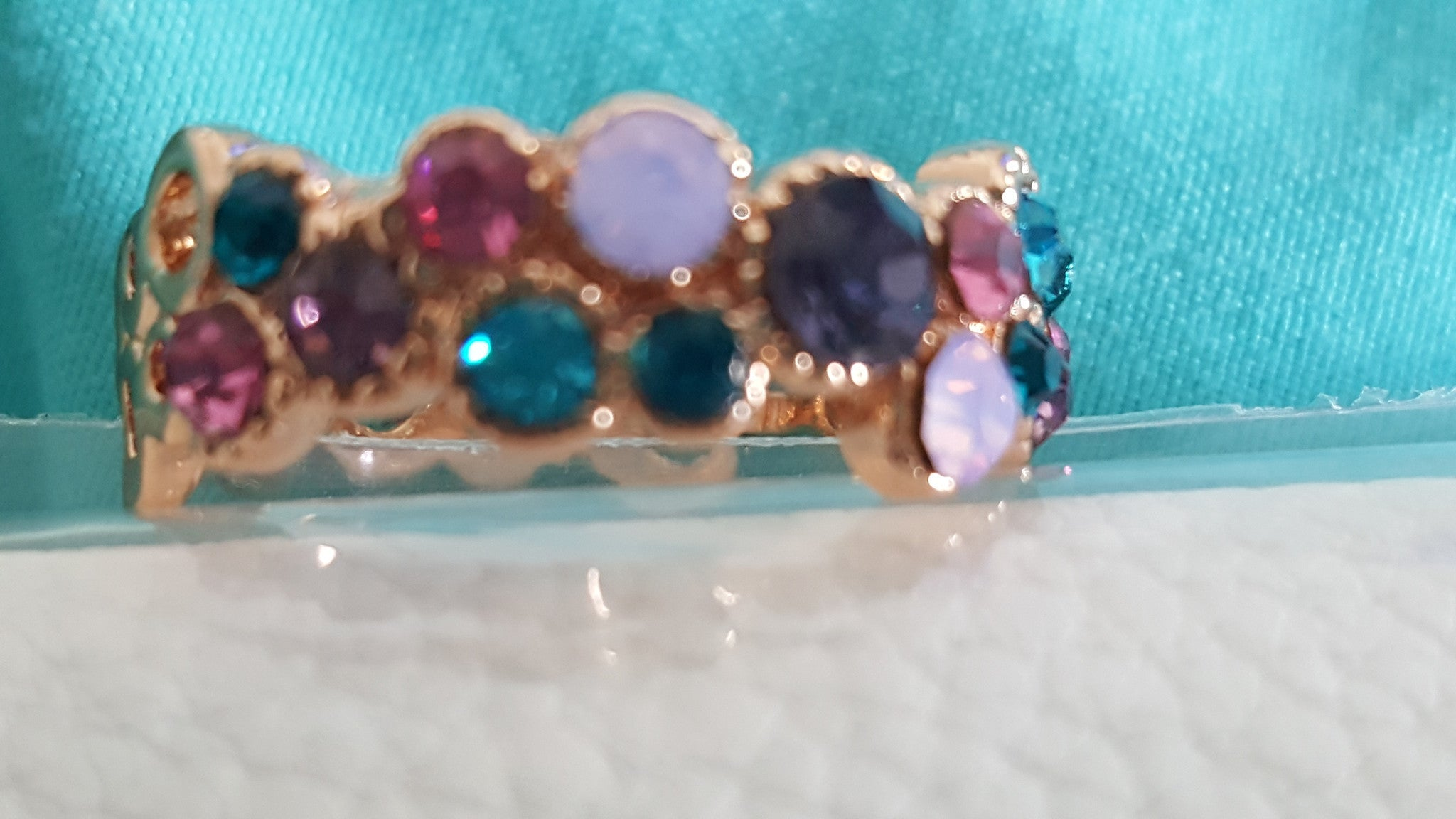 Swarovski gems with gold circling the ring. -  New Fashion Finds By Carole