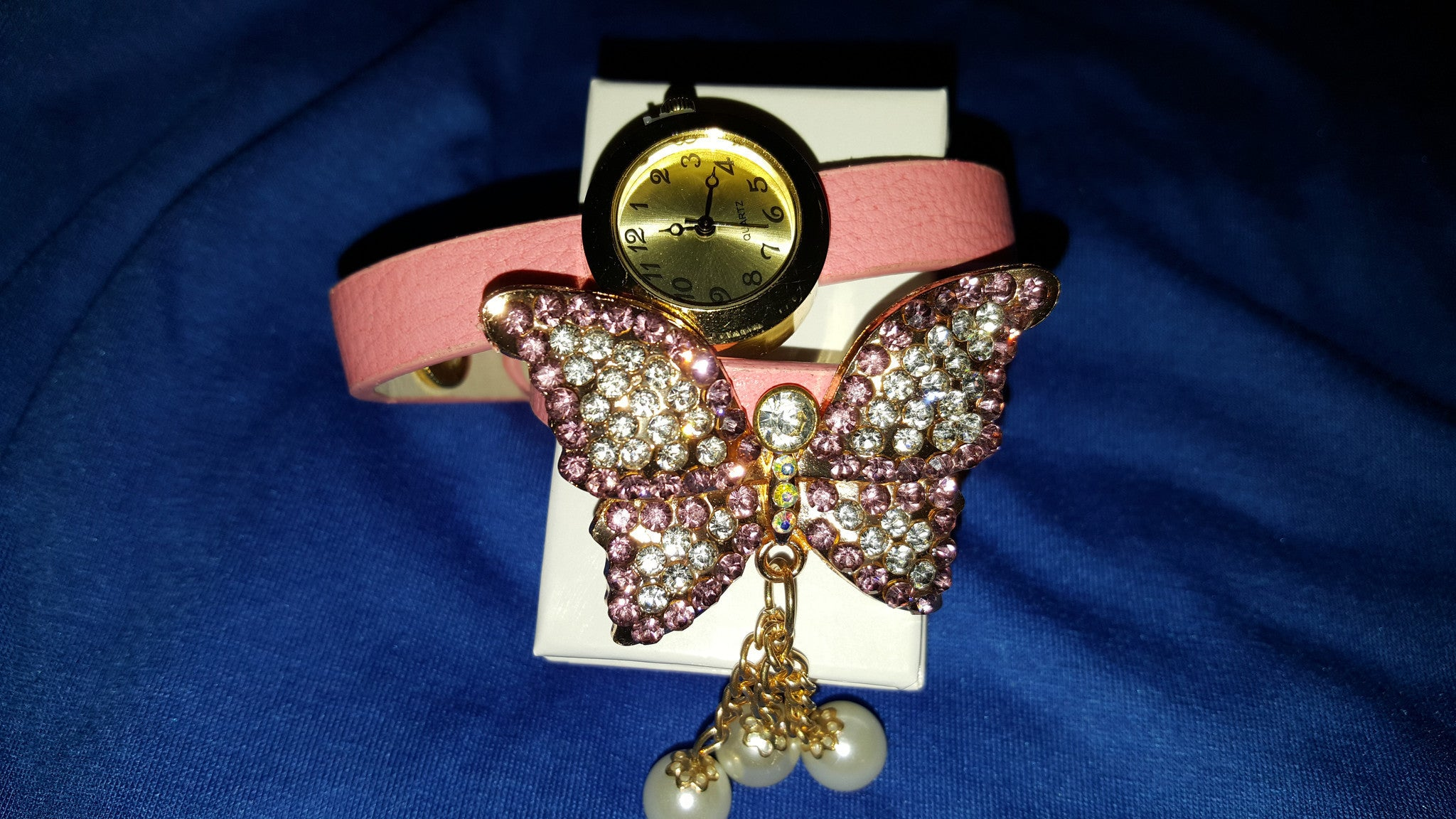 Wrap around pink watch band with beautiful sparkling butterfly. -  New Fashion Finds By Carole