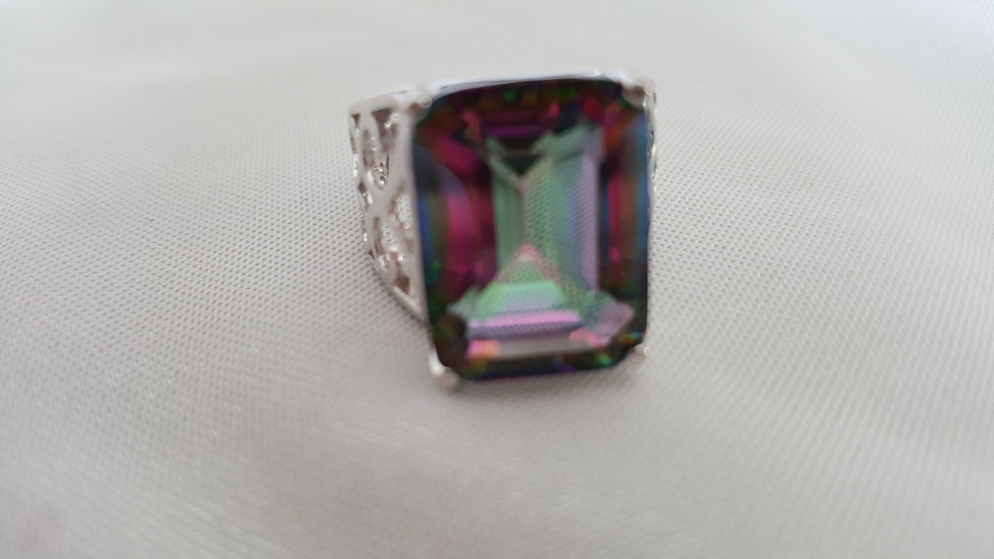The ring contains 10.10 CTW AAA Rainbow Mystic Topaz. -  New Fashion Finds By Carole