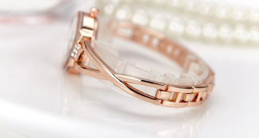 Elegant design criss-cross bangle watch with rhinestone.  -  New Fashion Finds By Carole