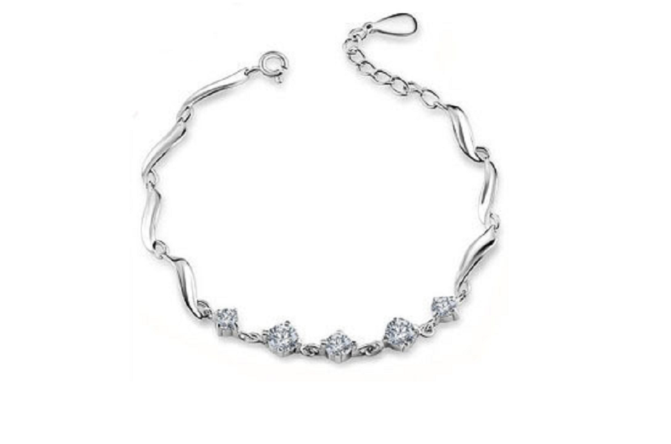 This delicate sterling silver bracelet is sure to please! -  New Fashion Finds By Carole
