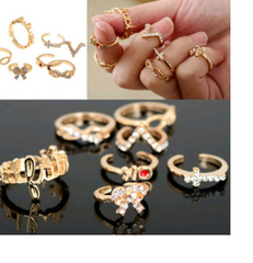 Fun, trendy 5 pc knuckle ring set. Mixed rings in package. -  New Fashion Finds By Carole