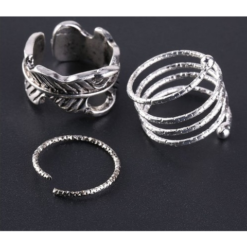 Fun, trendy 5 pc knuckle ring set. Mixed rings in package.