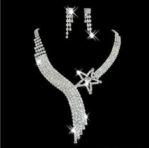 Set of beautiful choker, earrings, bracelet and ring.