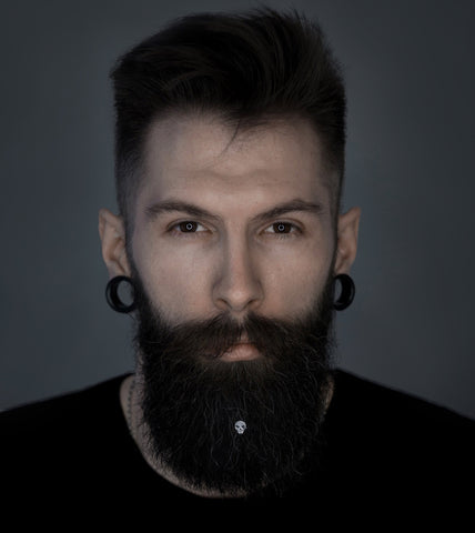 Skull beard piercing is a simple Halloween idea for a bearded men