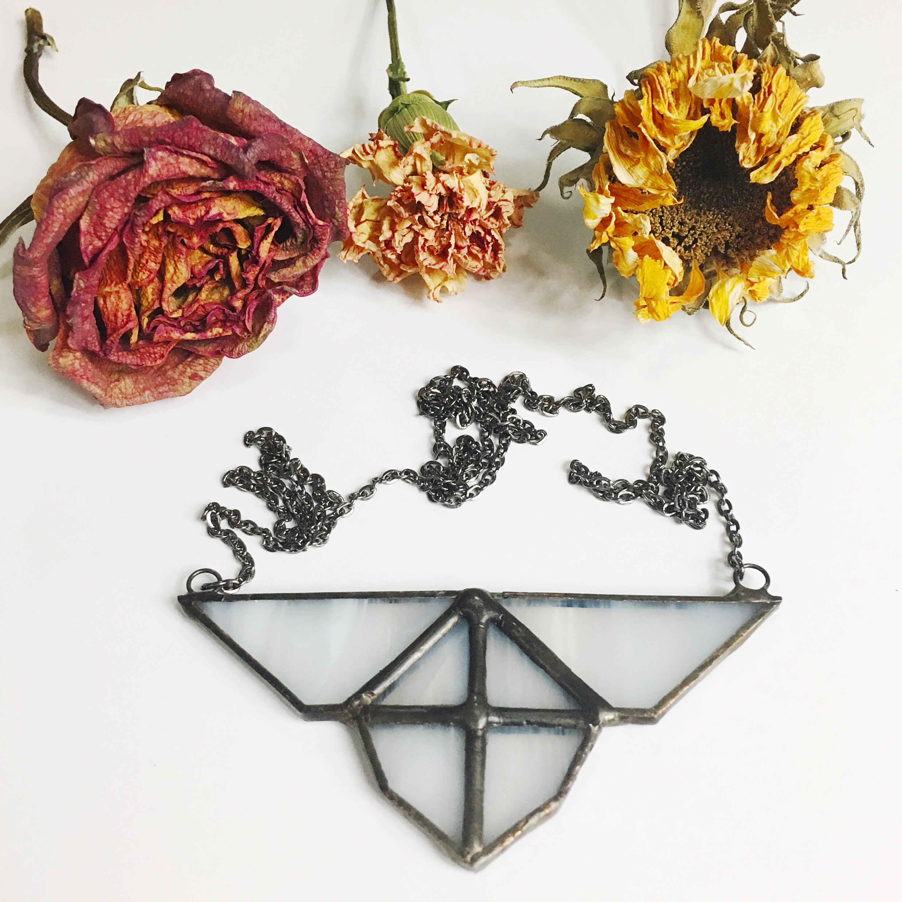 triangle glass and flowers